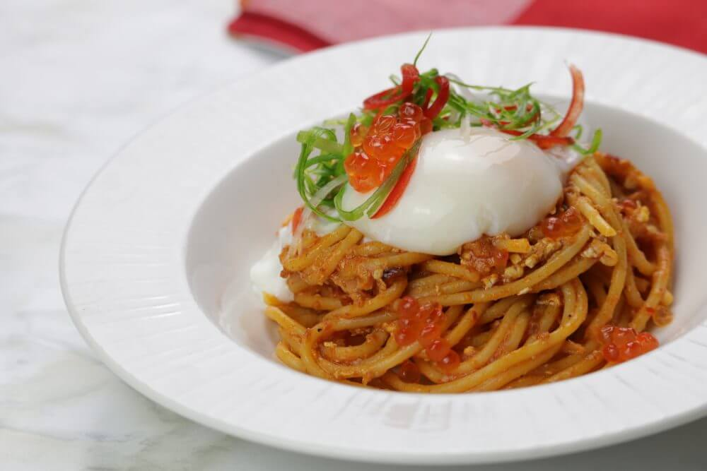 singapore chilli crab pasta with onsen egg and salmon roe